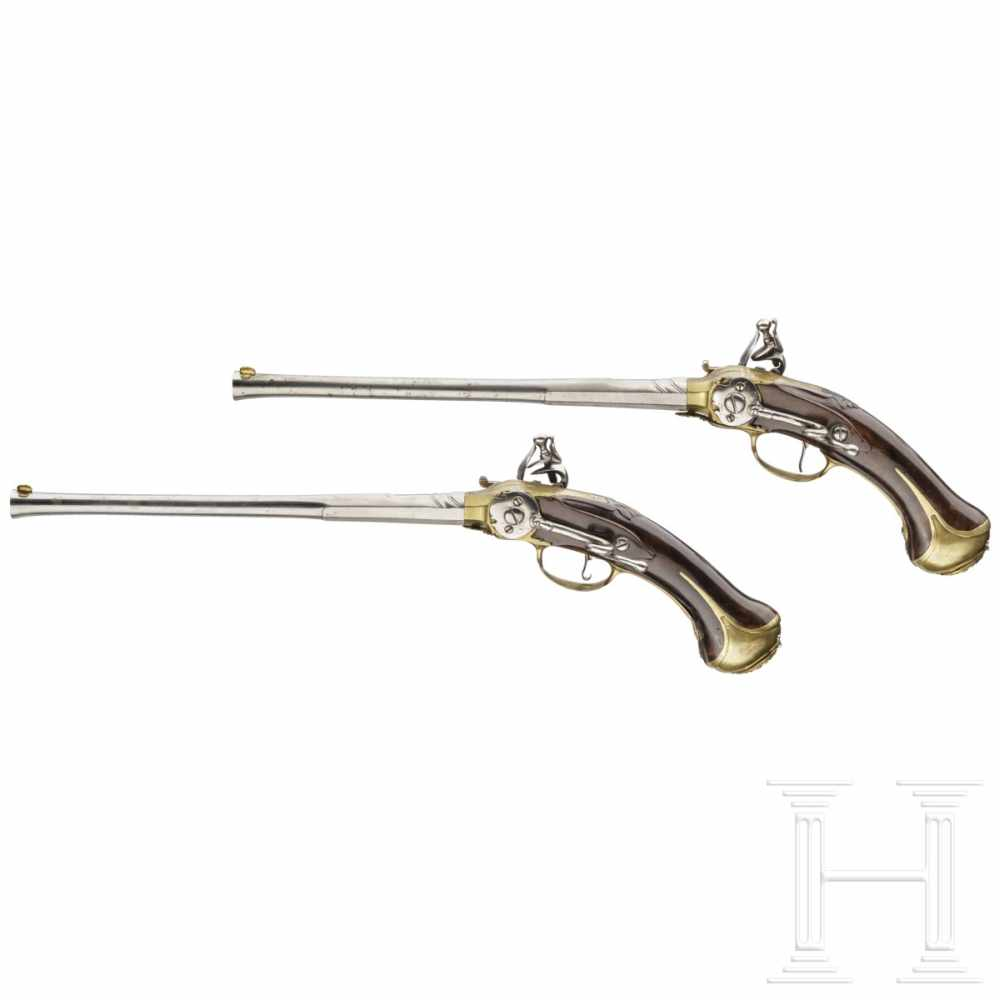 Lot 2029 - A pair of unusual self-loading flintlock pistols, Emanuel Wetschgin in Augsburg, circa 1710Octagonal