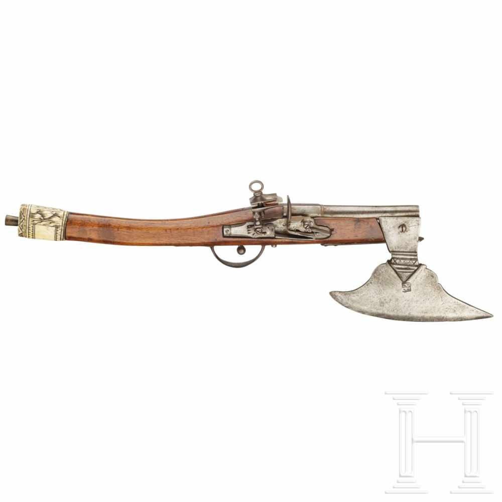 Lot 2005 - A rare battle axe with integrated flintlock pistol, probably Saxony, 18th centuryThe slightly semi-