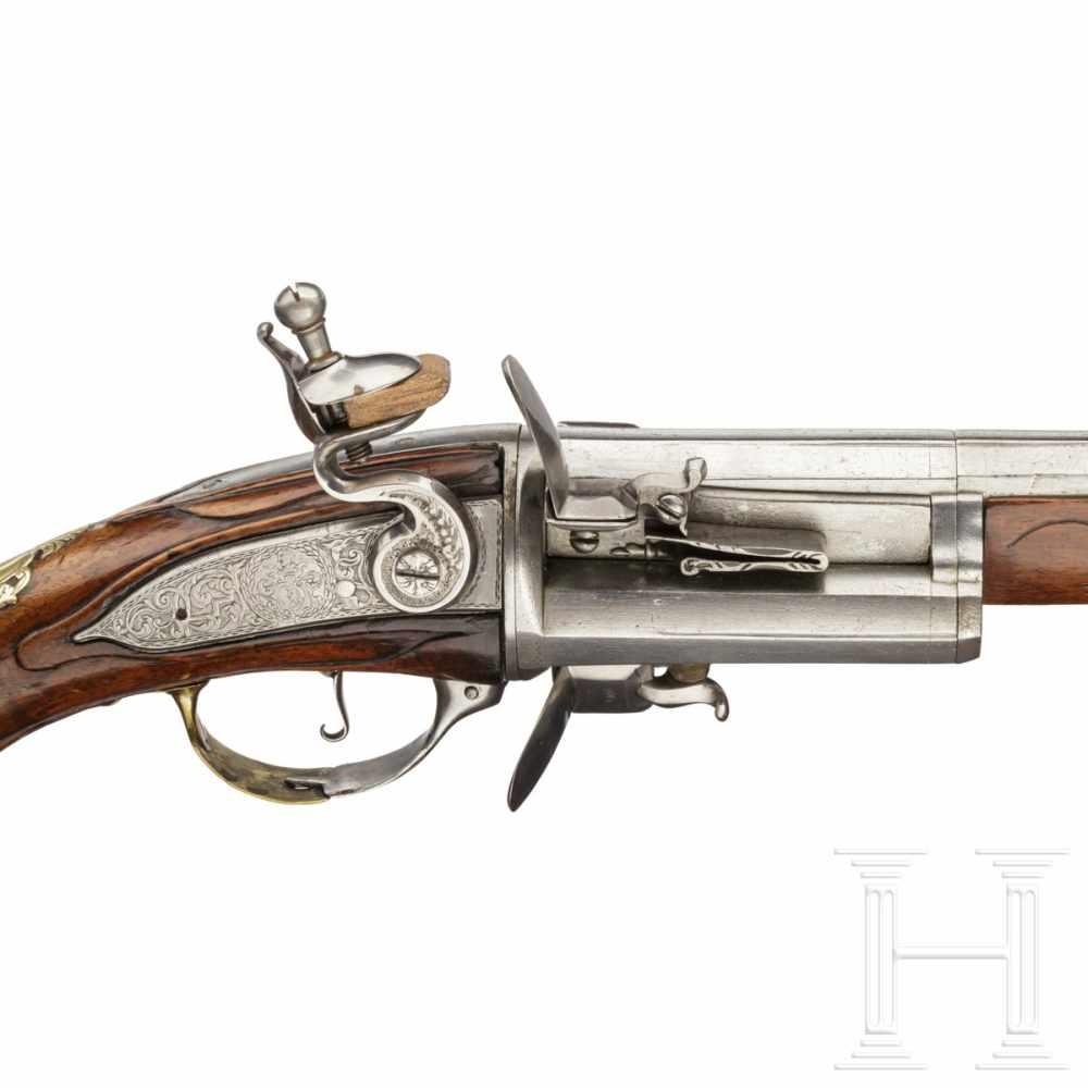 Lot 2031 - A German/Flemish three-shot revolving flintlock pistol, circa 1730Six-groove rifled barrel (no