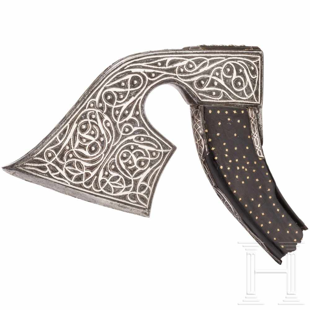 Lot 1038 - A splendid Ottoman axe head, 18th centuryLight, strongly curved axe head chiselled and inlaid in