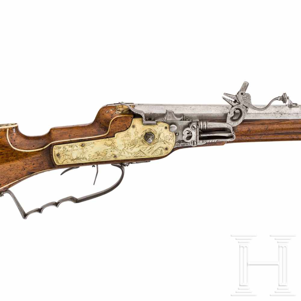 Lot 3021 - A southern German wheellock rifle with fine bone veneer, circa 1630/40Octagonal barrel slightly