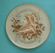1897 Jubilee: a large circular pottery plaque moulded with a head in profile