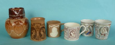 Victoria: a Doulton Lambeth brown jug for 1897 also four mugs and a beaker, tapering mug