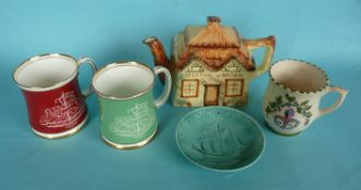 1951 Festival of Britain: a cottage teapot by Paramount Pottery, two Paragon mugs, another