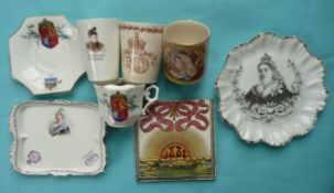 Victoria: a tile, a moustache cup, saucer and beaker for 1887; a mug & a continental plate for 1897
