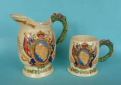 1937 Coronation: a Crown Devon musical jug to play 'Heres a Health' 208mm and a similar mug (2)