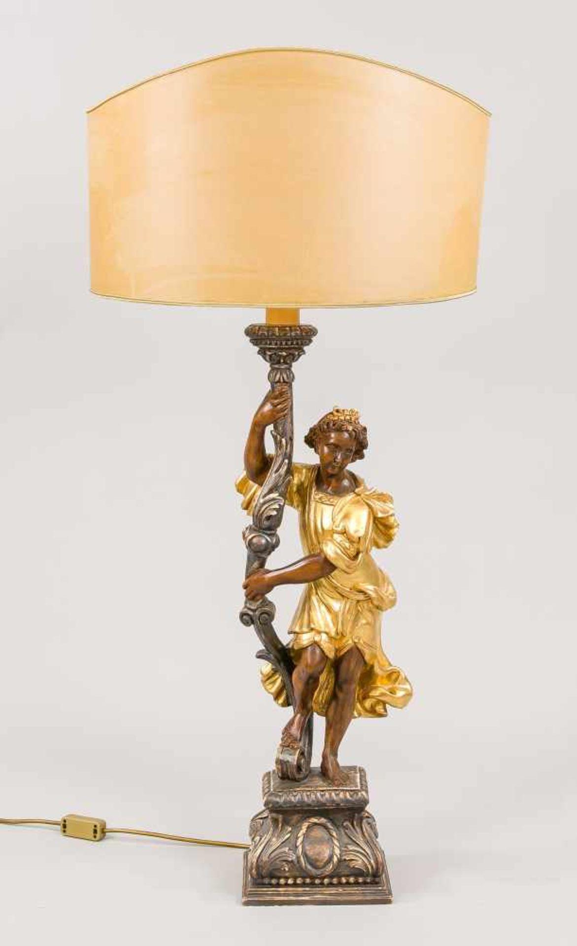 Figürliche Tischlampe, Mitte 20. Jh., Lindenholz, monochrom (braun) und Gold staffiert.