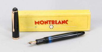 Montblanc Kolbenfüller, 2. H. 20. Jh., mit 585er Goldfeder, minimal ber., in original