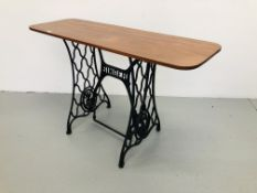 A SINGER CAST TREADLE SEWING MACHINE BASE CONVERTED TO SIDE TABLE