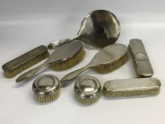 A SILVER FOUR PIECE BRUSH AND MIRROR SET