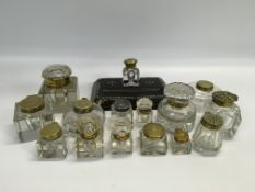A COLLECTION OF 16 ANTIQUE GLASS INKWELL