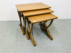 A NEST OF THREE NATHAN TEAK RETRO GRADUATED OCCASIONAL TABLES