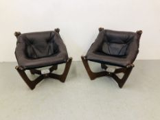 A PAIR OF DESIGNER EASY CHAIRS WITH LEATHER SEATS