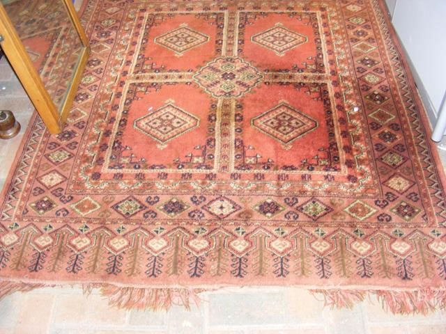 Lot 22 - An antique Middle Eastern rug with geometric borde