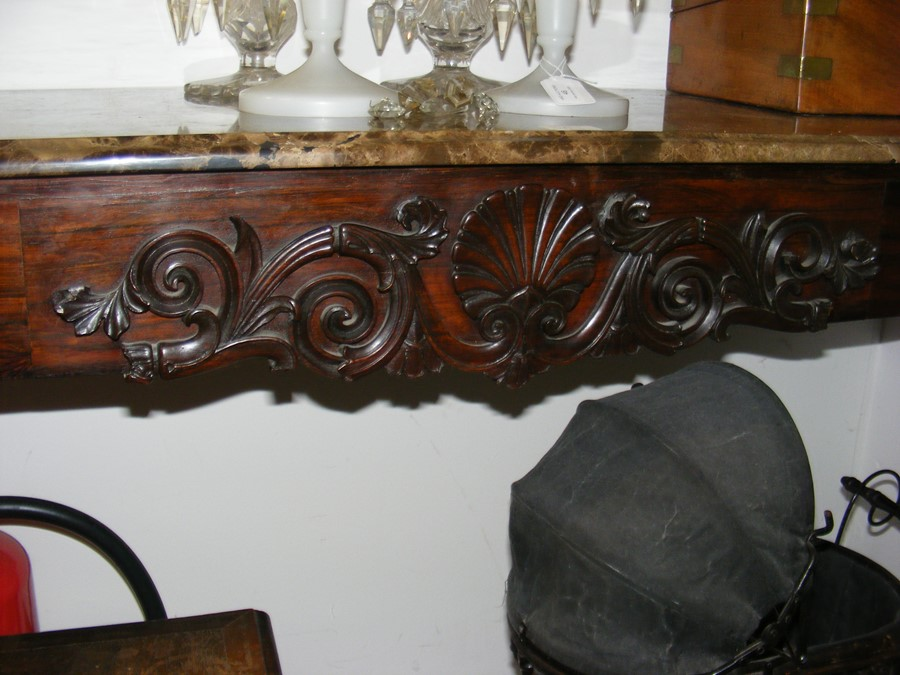 Lot 41 - A decoratively carved console table with cabriole