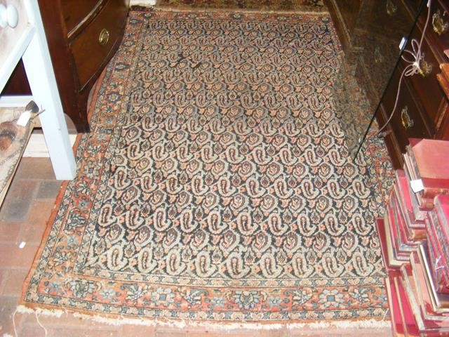 Lot 26 - An antique Middle Eastern rug with geometric borde