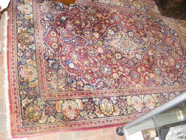 Lot 18 - An old Middle Eastern rug with geometric floral bo
