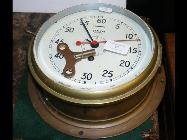 Lot 29 - A Smith circular bulkhead clock - 22cm diameter