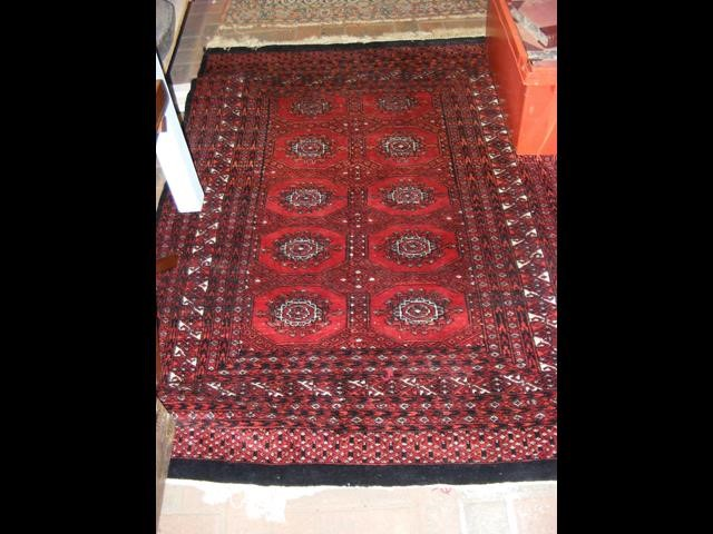 Lot 25 - A Middle Eastern rug with geometric border and red
