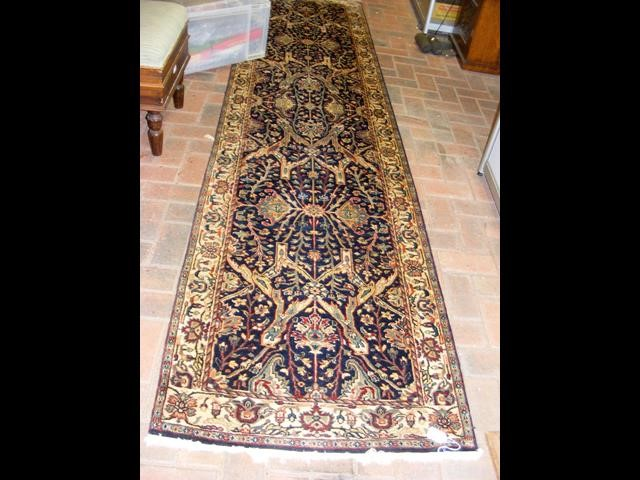 Lot 23 - A Middle Eastern style runner with geometric borde