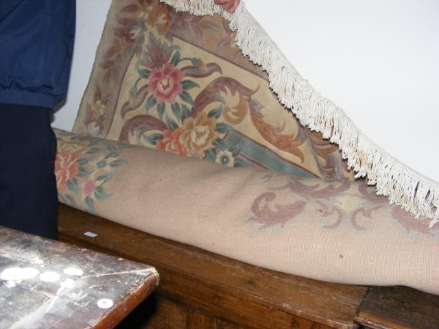 Lot 5 - A large Chinese carpet with floral border