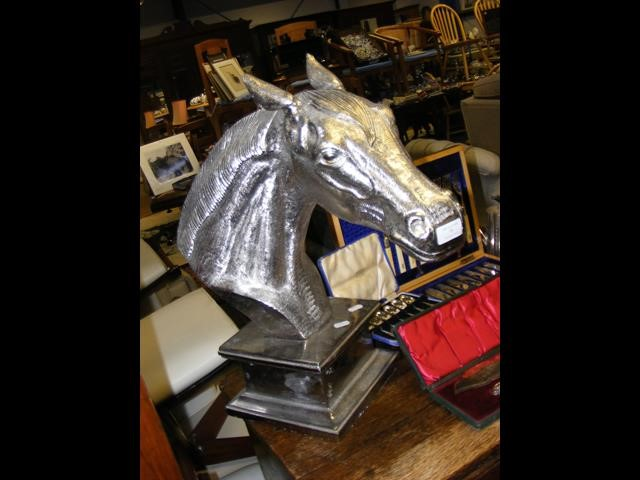 Lot 15 - A silvered cast metal horse head on plinth - 54cm high