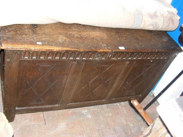 Lot 2 - An antique panelled oak coffer - 128cm