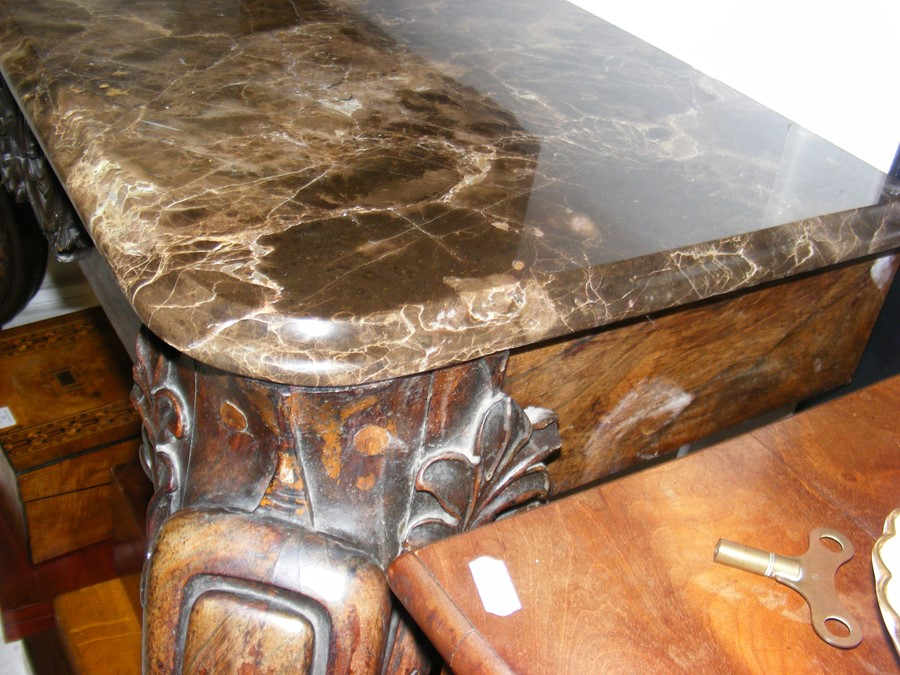 Lot 42 - A decoratively carved console table with cabriole