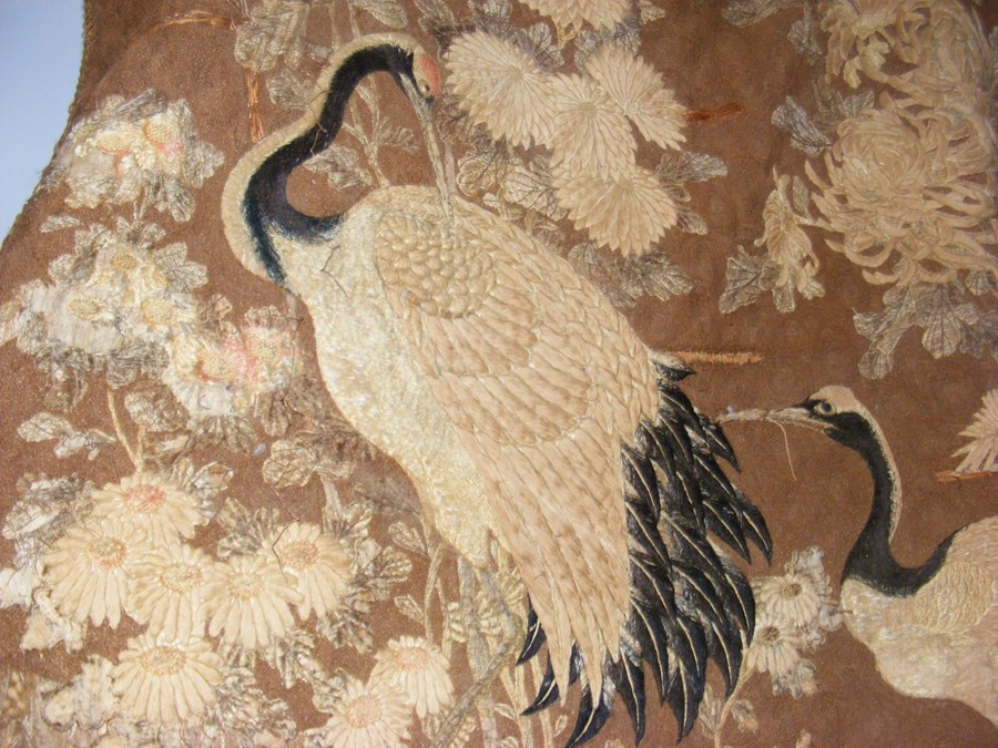 Lot 14 - An old oriental tapestry with exotic birds and flo