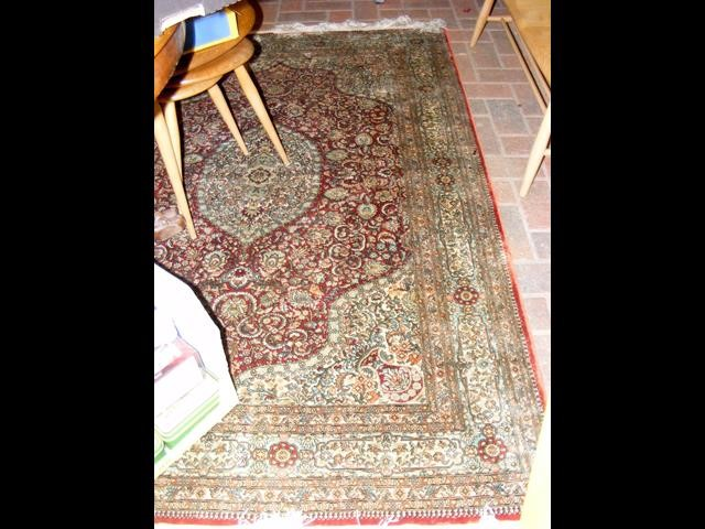 Lot 24 - A finely woven Middle Eastern rug with geometric b