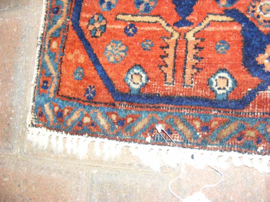 Lot 20 - A Middle Eastern rug with geometric border