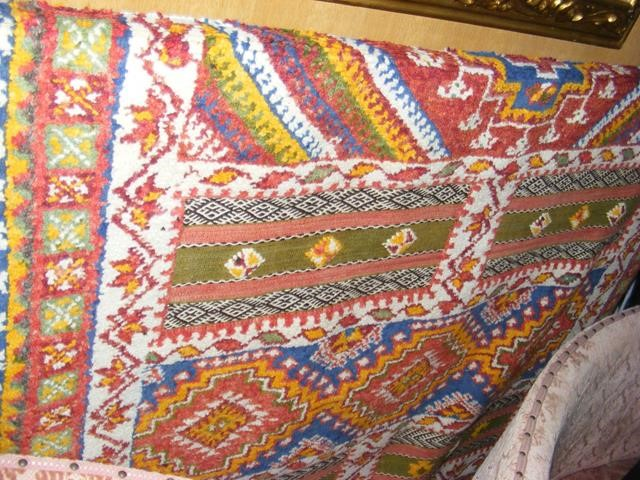 Lot 10 - A Middle Eastern style carpet with geometric borde