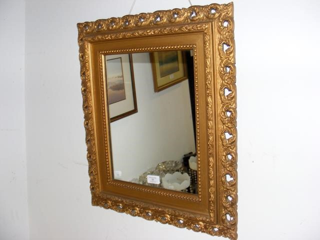 Lot 36 - A small antique gilt framed wall mirror - 55cm x 4