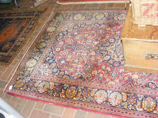 Lot 17 - An old Middle Eastern rug with geometric floral bo