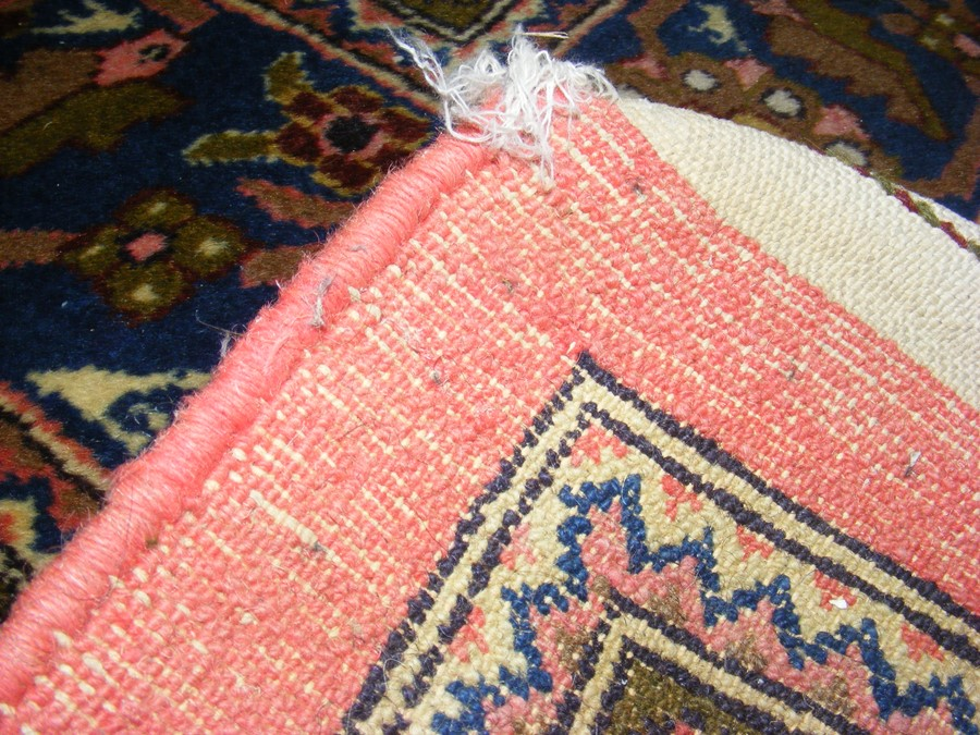 Lot 16 - A large Middle Eastern style carpet with geometric