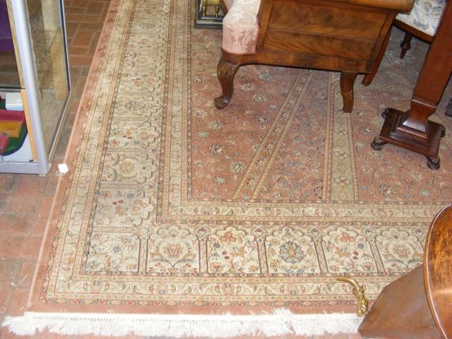 Lot 19 - A Middle Eastern style carpet with geometric flora