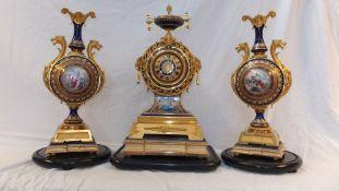 A Victorian, exhibition quality, three piece clock