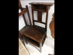 An unusual prayer/hall chair with hinged lift-up seat