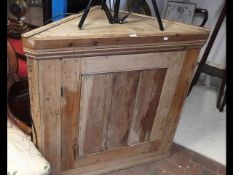 An antique pine corner cupboard - 104cm