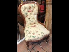 An antique button back easy chair