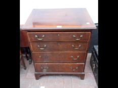An antique mahogany chest of four graduated drawer