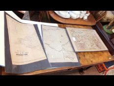 A folio containing various early hand coloured map
