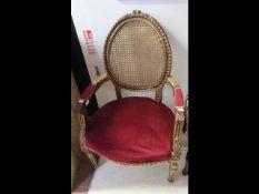 A gilt framed French style armchair
