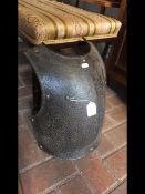 A 40cm high cast metal breast plate