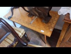 A mid-century matchstick top coffee table with spi