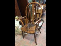 A 19th century wheel back armchair on turned suppo