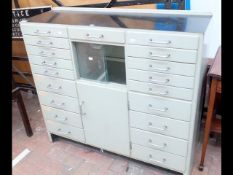 A vintage Dentist's cabinet with multi-drawer front and centre cabinet