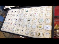 A tray containing various collectable gems, includ