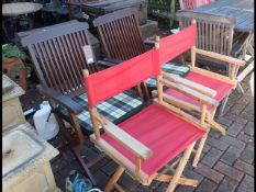 Two folding directors chairs together with two gar