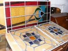 A pair of rectangular stain glass window panels to